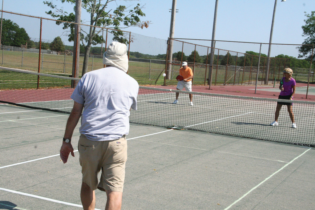 GOING FOR A POINT: Bob Vinacco and Jackie Sweet cover the court.