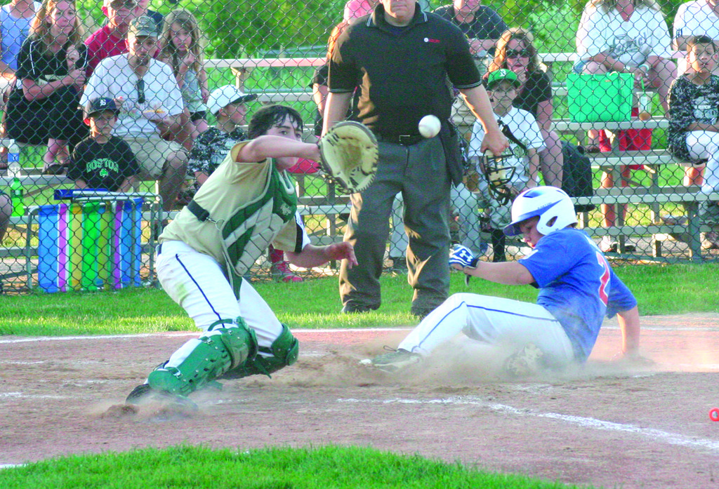 IN THERE: Cody Anter slides into home for Continental just before West Side catcher Max Caracuzzo can catch a throw. Anter went 4-for-4 as Continental won 13-3.