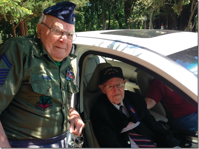 PATRIOTIC PARTICIPANTS:  Frank Sousa of Lynnfield MA, age 90, at left who served throughout Europe during WWII Gerry Latham of Warwick Neck, 104, who served in the South Pacific joined in the parade.