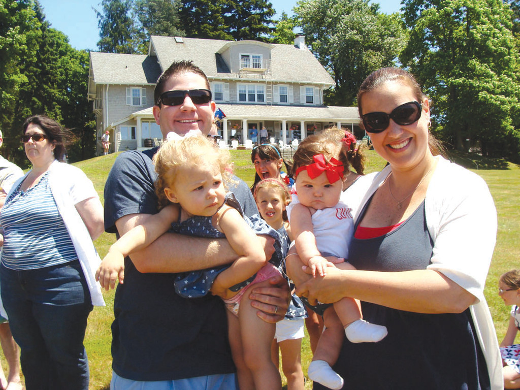 YOUNGEST WINNER: Meghan Wurtz, at 5 months old, won the award for being the youngest participant in Warwick Neck�s Fourth of July parade on Saturday. She is pictured above with her mother, Christine Wurtz, her older sister Quinn and her uncle Brendan Walters.