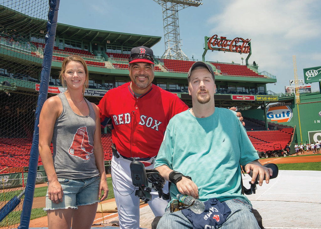 VETERANS AND FENWAY: Boston Red Sox Assistant Hitting Coach Victor Rodriguez takes a moment to pose with U.S. Marine Corps veteran Jason Januskiewiczy of Warwick and his sister Tanya Montoya of Warwick at Fenway Park during a special CVS Caremark Baseball Camp held July 2 at the park. Januskiewiczy was one of 16 veterans of all abilities from across New England who participated in the camp – put on by CVS Caremark and the Boston Red Sox as a tribute to the veterans for their service to the United States and in honor of Independence Day.