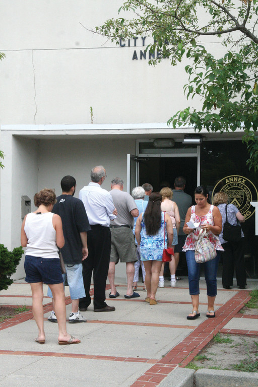 IT'S COOLER INSIDE: While the line of taxpayers stretched outside the City Hall Annex building yesterday, conditions inside were much cooler than they were last week thanks to two temporary air conditioners. First quarterly tax payments are due today.