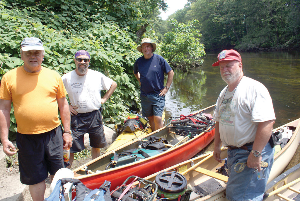 RIVER RIDE: Pictured are Bill Luther, Chuck Horbert, Dave Smith and Jim Cole about to leave the canoe launch at Pontiac Avenue and Knight Street in Cranston after making a stop on their eight-day journey along the rivers of Rhode Island.