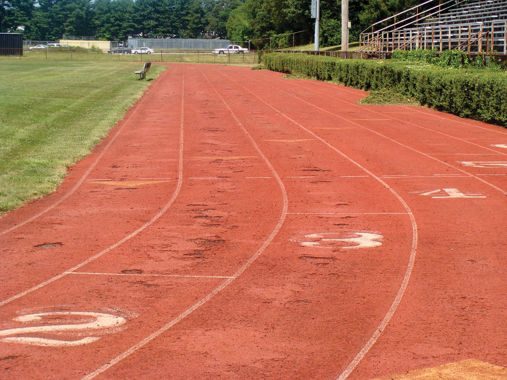 RUNNING FOR A FIX: The Pilgrim track is covered in holes and tears, especially in the middle lane. Athletes, coaches and the public would all like to see the track fixed. Without repairs, the track may soon become too dangerous to use at all.