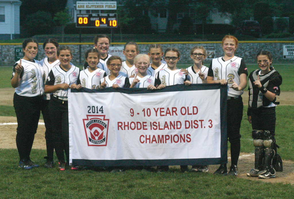 FOUR-PEAT: The Warwick West Side 9/10-year-old softball team poses with its District 3 banner.