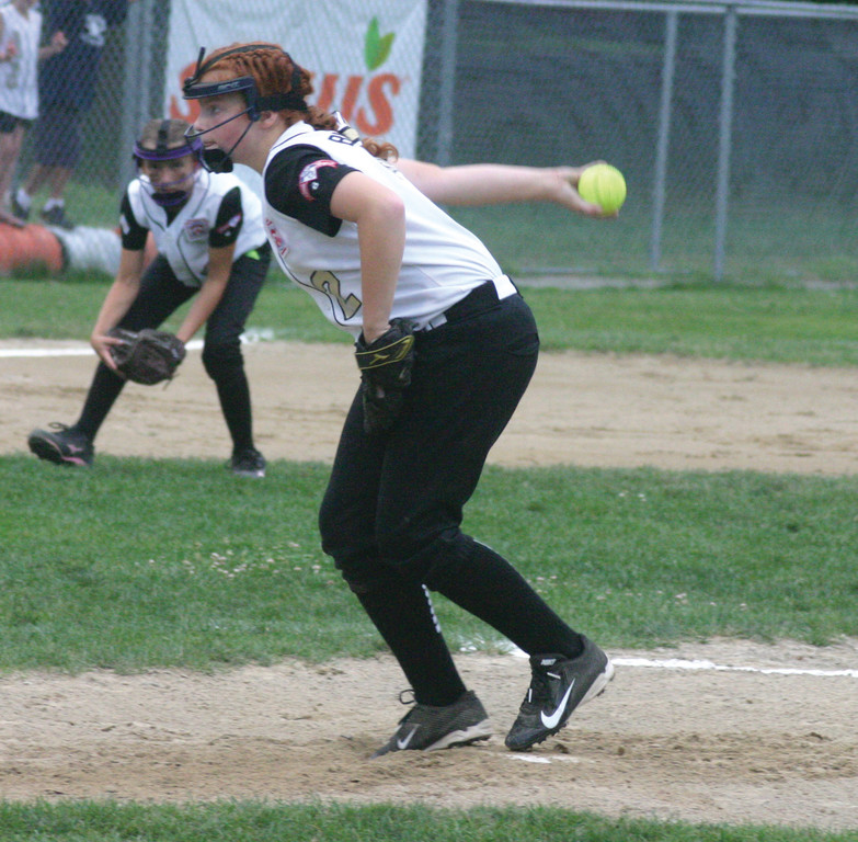 Kelsey Burr fires a pitch during Tuesday's District 3 championship game. Burr finished with 10 strikeouts and earned the victory.