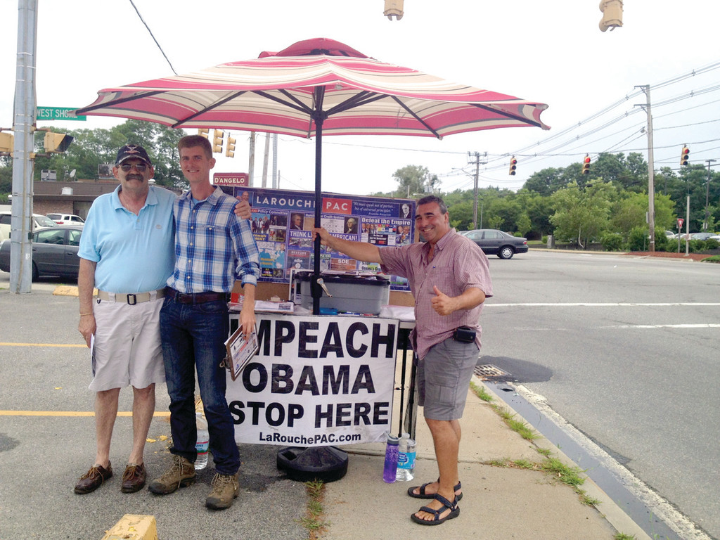 "AROUND THE FRINGE: Pictured from left is supporter Gary Anthony Tougas and organizers Ryan McCusker and Kevin Pearl telling drivers to, ""Pull in and sign up"" and donate to their movement to impeach the president. Anti-Obama signs like this faced drivers at the intersection of Airport Road and Warwick Avenue on Tuesday, provoking mixed results."