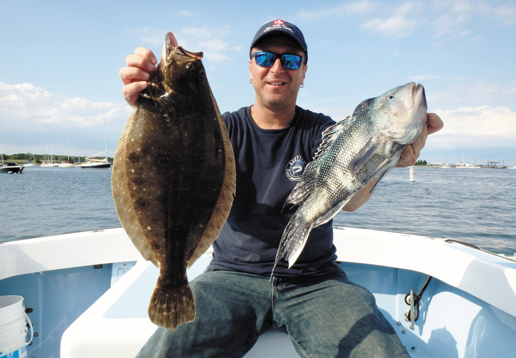 Steve Brustein of West Warwick with some of the fluke and black sea bass caught off Seal Ledge, Newport last week.