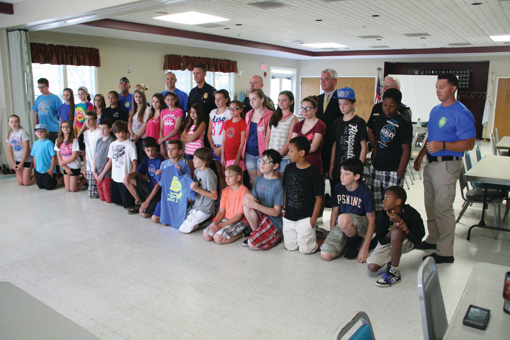 CAMP PHOTO: Campers, school resource officers who run Leadership Camp and officials who addressed them on the last day of camp Friday gathered for a group photo.