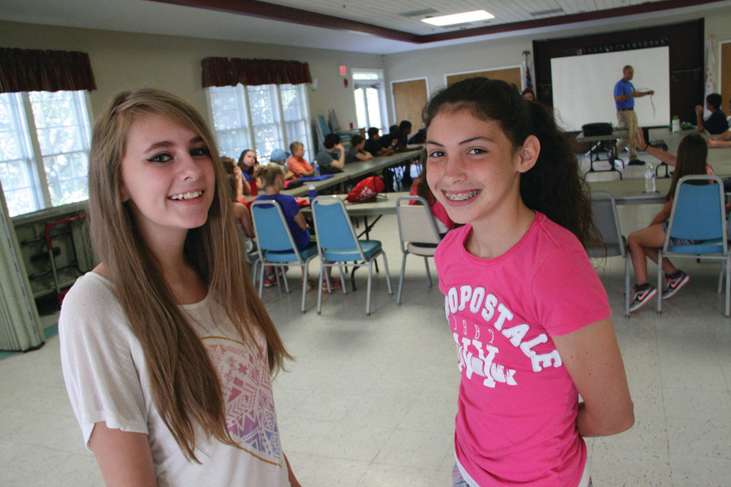 CAMP VETERANS: Both Daphne Eckert and Hannah French, who attended the camp last summer, enjoy the opportunity to make new friends.