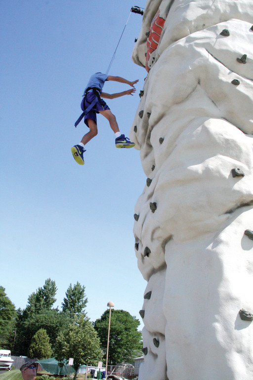 EASY WAY DOWN: Adian O�Sullivan bounds off the climbing wall after having made a quick ascent.