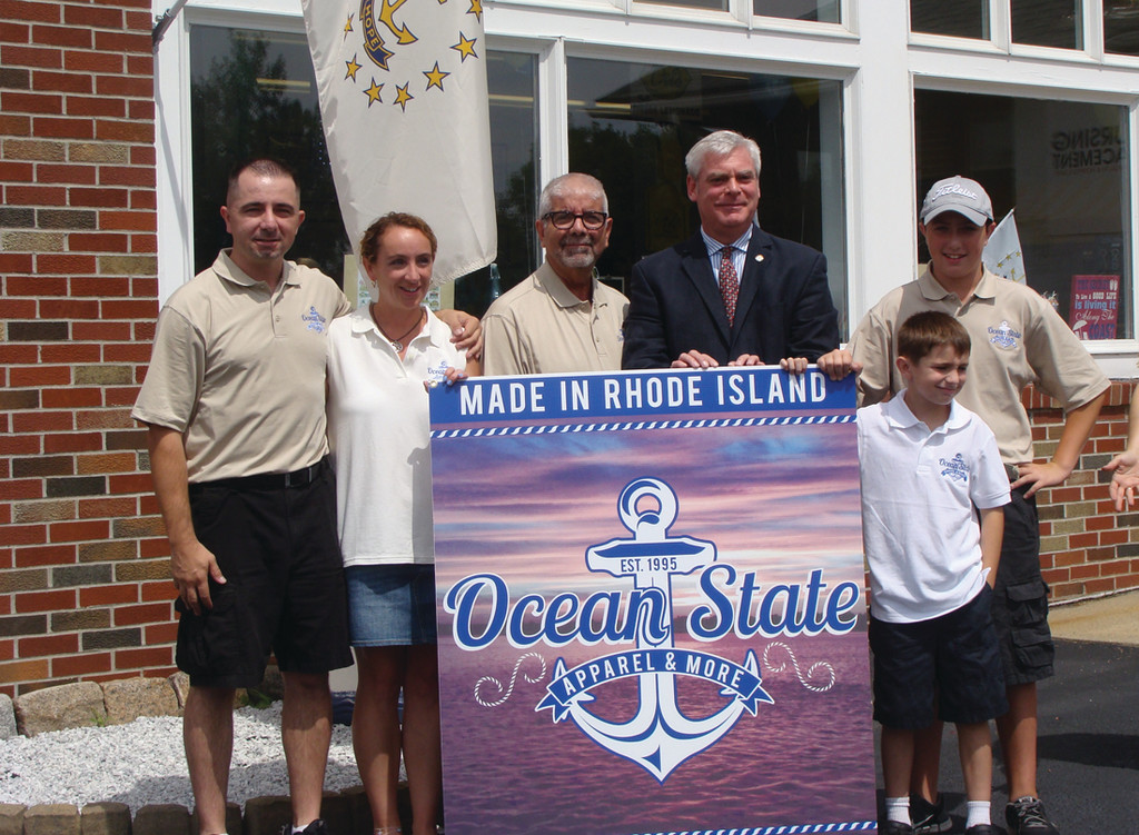 FAMILY TIME: Three generations of the Cabral family worked together to open Ocean State Apparel & More on Post Road. They are pictured left to right, Michael Cabral, his wife Cara, father Richard, his eldest son Connor and youngest Aiden. The family aspect to the business has been instrumental in the success of the opening. Mayor Scott Avedisian attended the Grand Opening and ribbon cutting on July 17.