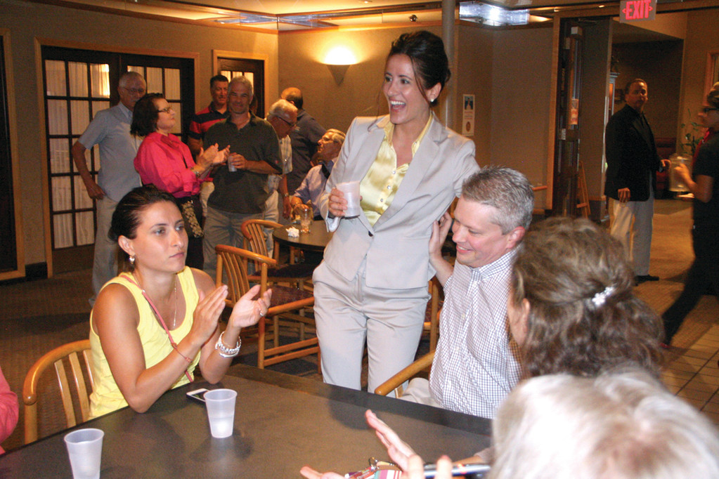 DELAYED HONEMOON: GOP mayoral candidate Stacia Petri shares a laugh with her fiancé, Jay Huyler, at her meet and greet event last Wednesday. They will be married next month, but the honeymoon has been put off until after the Sept. 9 primary.