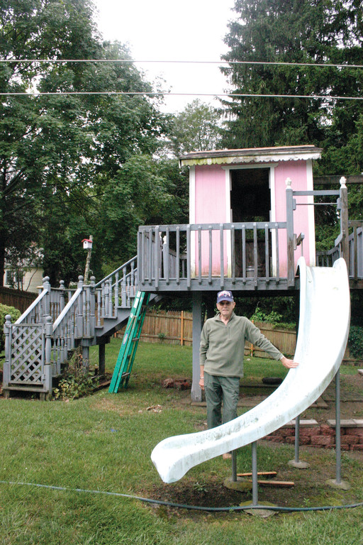 A BIT OF THE PARK: Ed Damaso built this freestanding tree house 27 years ago after rescuing a slide from the former Rocky Point saltwater pool that would have otherwise ended up in the trash.