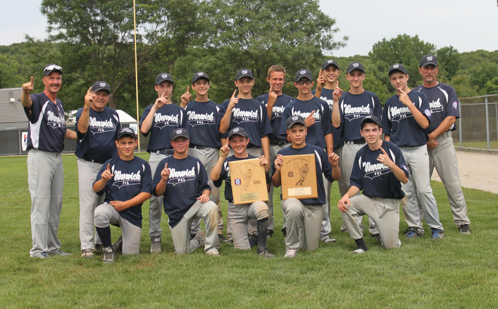 COMEBACK KIDS: The Warwick PAL 13-year-old all-star team gathers around its state championship trophy after winning the Babe Ruth state title on Saturday.