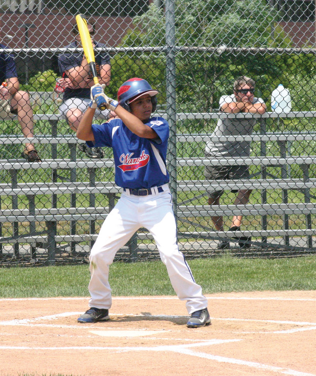 FINDING A WAY: Tyrell Bernal gets in his stance at the plate during a game in the District 3 Tournament. Bernal and his Continental teammates are one win away from capturing the 11-year-old state championship.