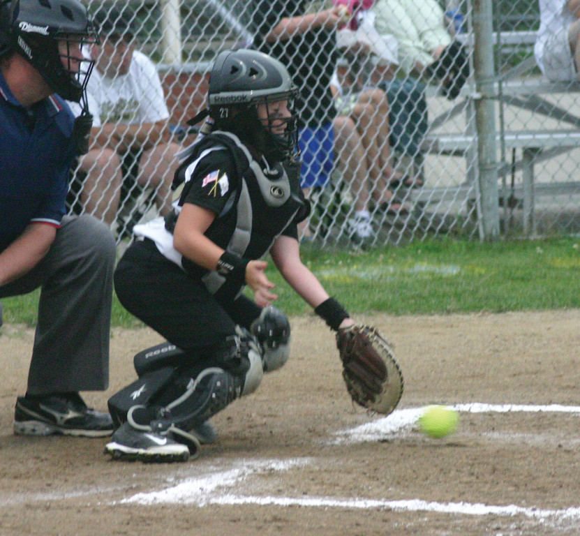 Maddy D'Amato blocks a ball behind the plate.