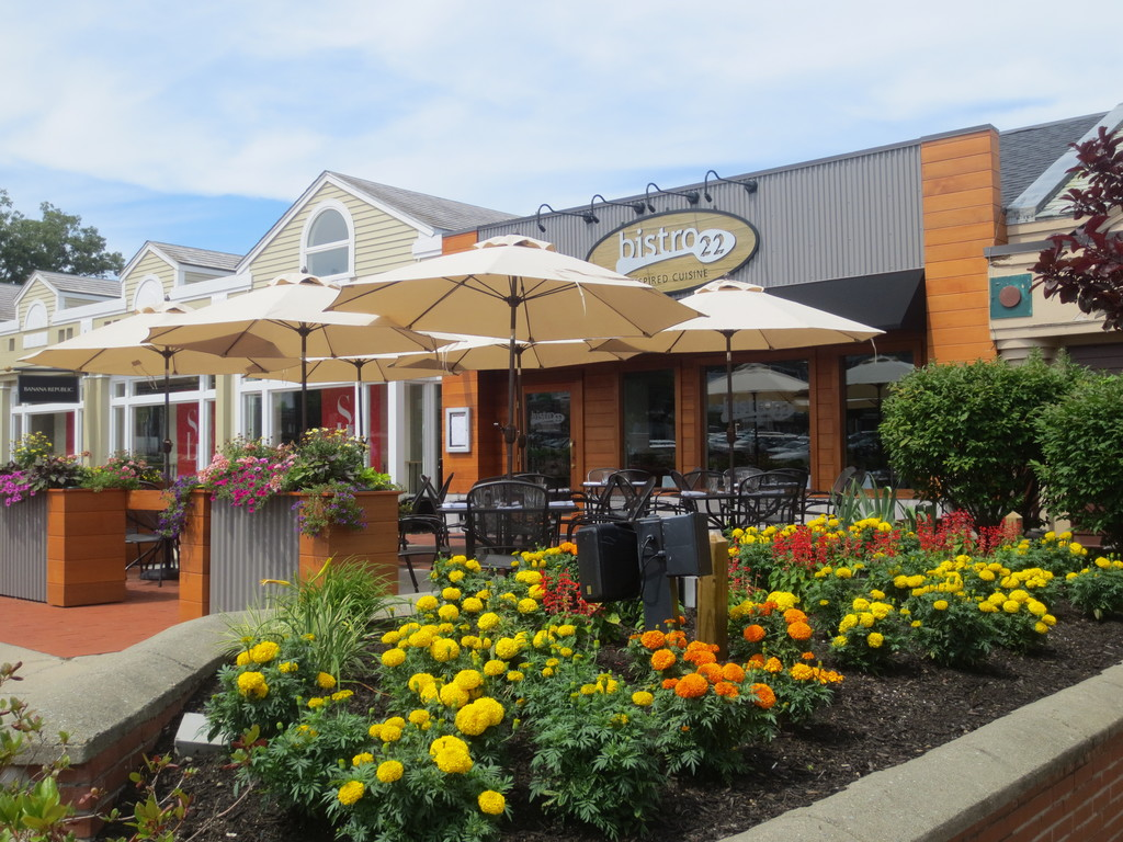 Enjoy lunch or dinner on the shaded outdoor terrace of Cranston's newest destination in dining, Bistro 22 in Garden City Center.