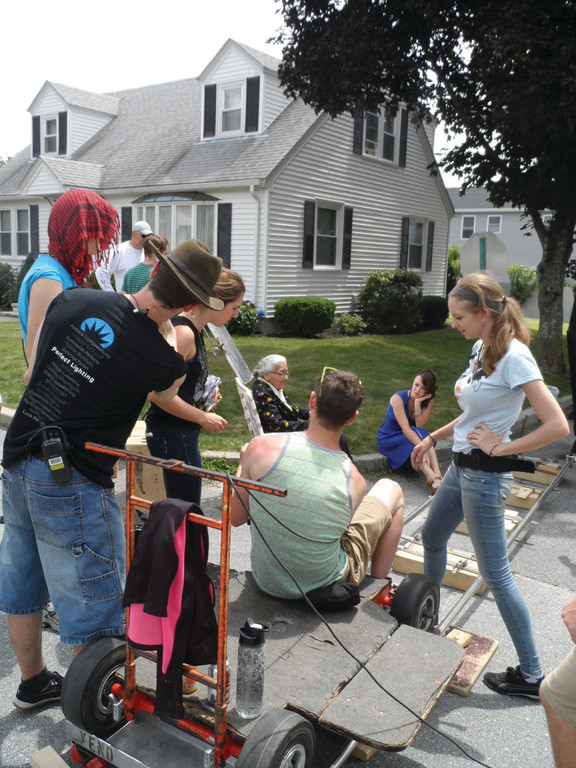 "YOUNG FILMMAKER: Aly Migliori works with actors and crew members while shooting a scene for ""Knightsville"" on Saturday."