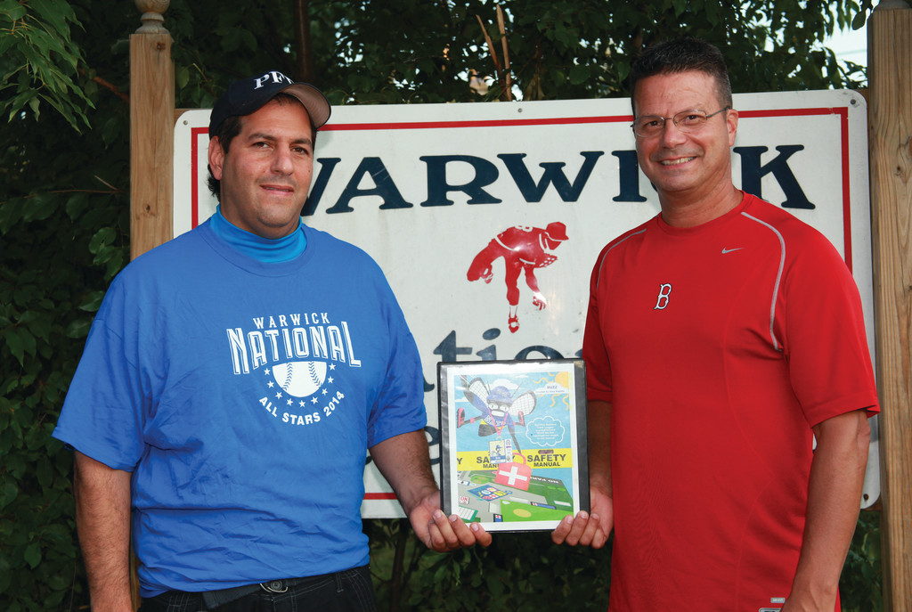 HIGH PRIASE: Warwick National president David Palumbo (left) and safety officer Bob Bubar pose with the award-winning plan after their Little League was selected as one of five finalists in the nation for the ASAP Award.