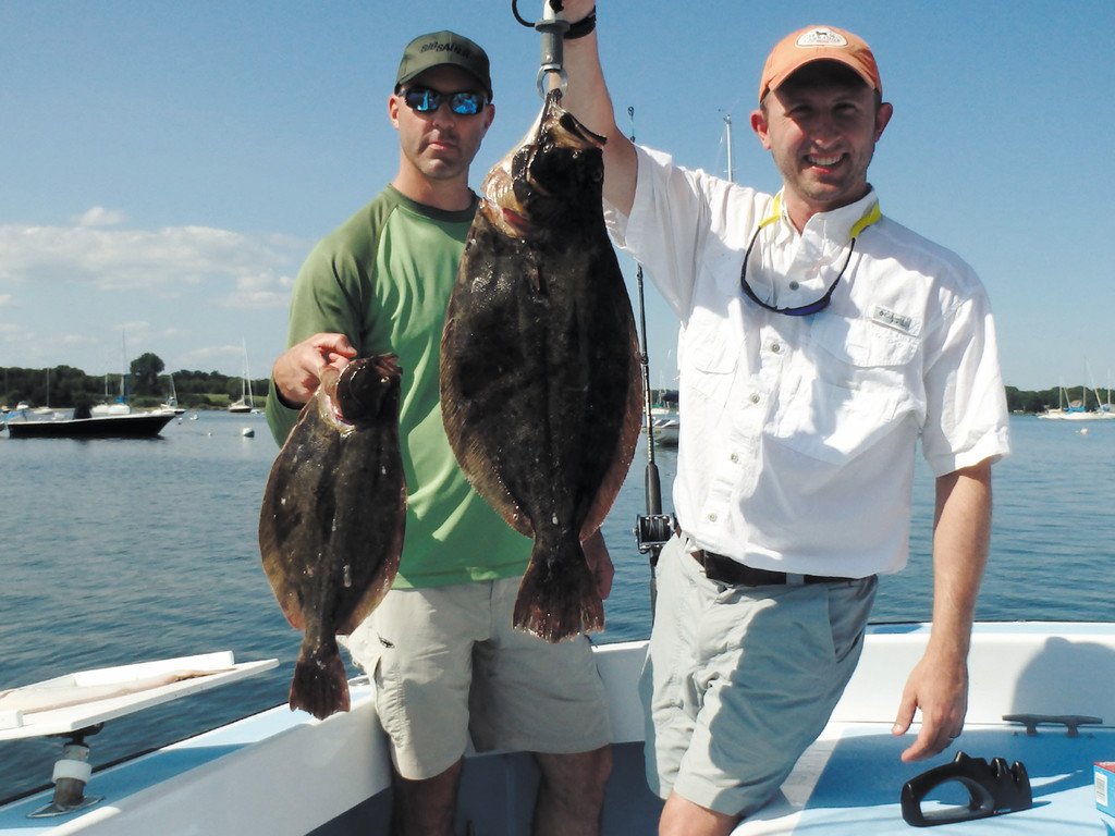 Fishing with friends: Chris Gasbaro found this 26-inch summer flounder one mile off Newport's Seal Ledge, he fished Monday with his friend and business associate Jason.