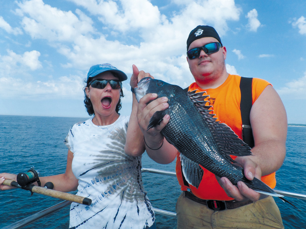 Christine Blount and her son Capt. Nicky Blount, both from Narragansett, RI, proudly display a jumbo sea bass caught aboard the Frances Fleet.