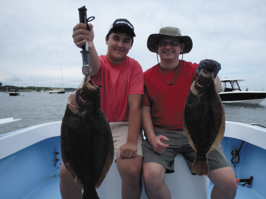 Alex and Joe Noga of Rye, N.Y. with two of the fifteen summer flounder (fluke) they caught off Newport Saturday on a family fishing trip.