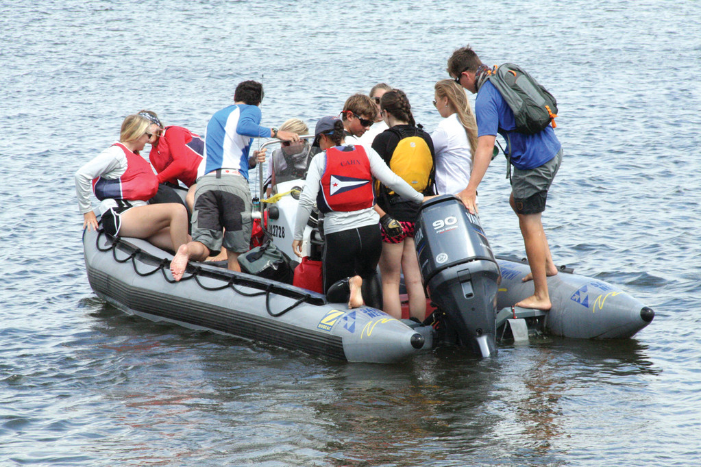 ROOM FOR ANOTHER? Crew members from Team Annapolis take to Greenwich Bay during yesterday�s CJ Buckley Regatta.
