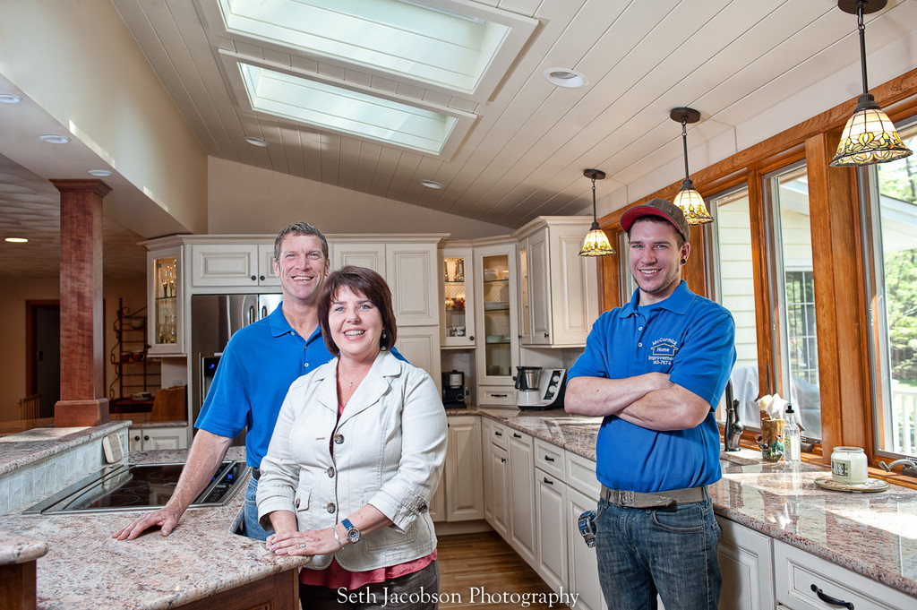 Owners of McCormick Home Improvement, LLC, Chris and Kristen McCormick and their son Garrett, showcase a kitchen remodel in Cumberland.