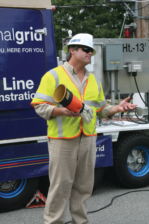 SAFETY FIRST: Firefighters attended the Live Line Demonstration by National Grid Monday. They watched on as National Grid workers highlighted the dangers of electricity, adding different objects to currents to see how they�d react.