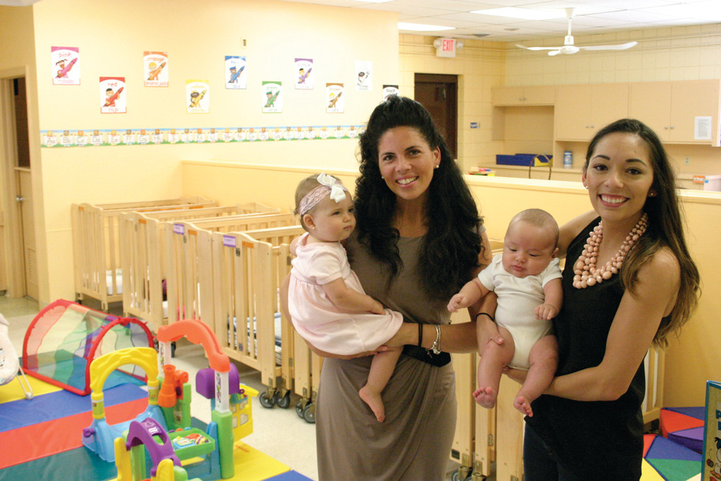 LIVING THEIR DREAM: Marlena DeLuca, left, holding her daughter Angelina, and Vanessa Faiola, holding her son Giancarlo, recently realized their dream of a foreign language immersion preschool with the opening of New Era Enrichment Academy.