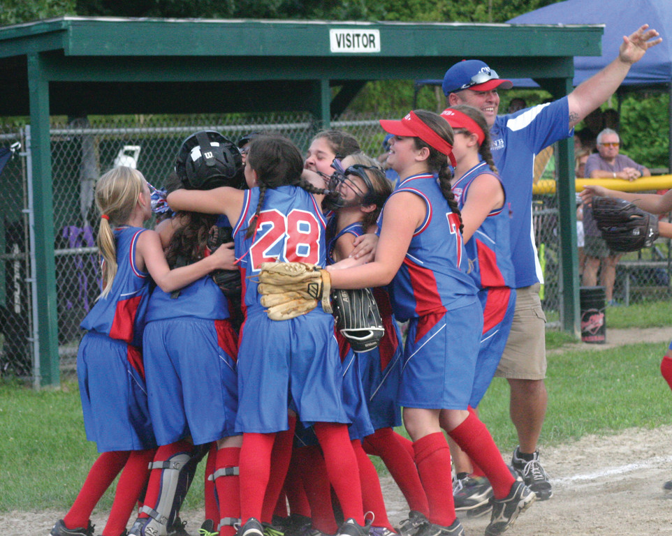 READY TO ROCK: CNB's 9/10 softball all-stars huddle during pregame at the Eastern Regional.