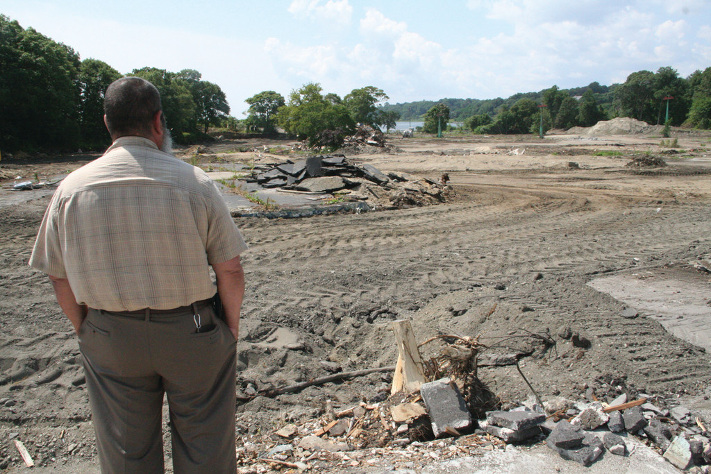 A NEW MIDWAY: Larry Mouradjian, of the Department of Environmental Management, looks out on a Rocky Point Midway nearly devoid of debris.