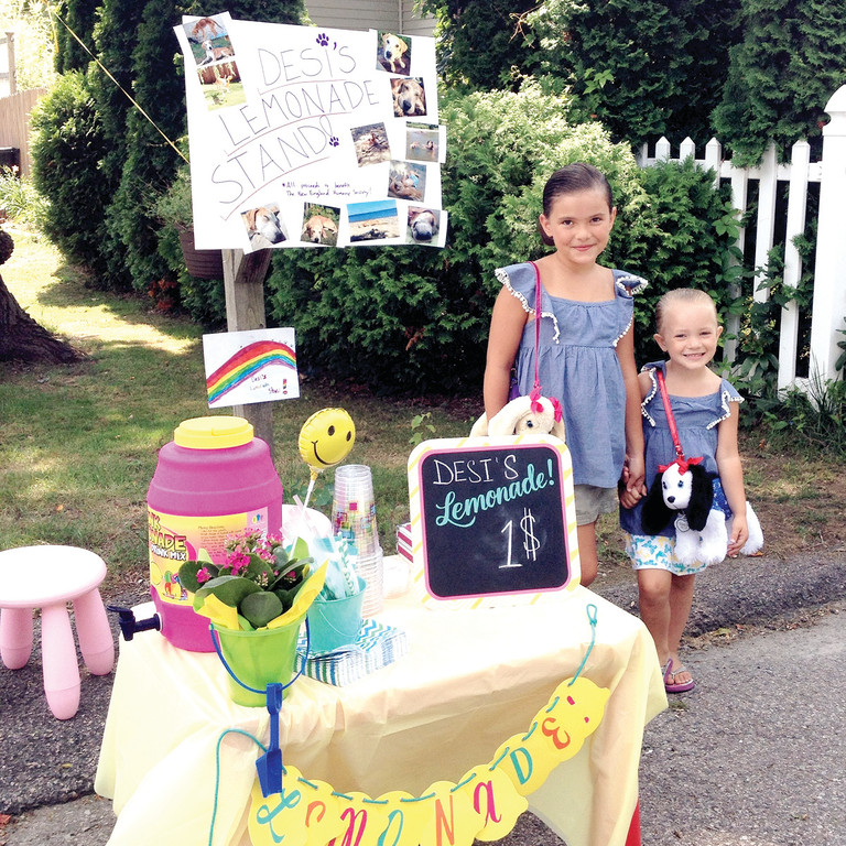 INSPIRED BY DESI: Isabelle and Chloe Hebert recently ran a lemonade stand to raise money for the New England Humane Society in Desi's honor.