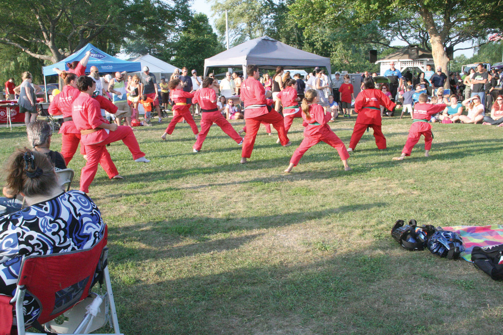 IN UNISON:  The Don Rodrigues Karate School put on a demonstration for the crowd