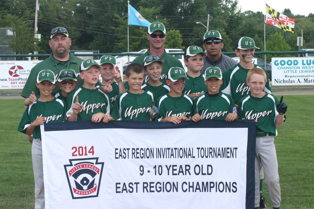 TOP DOGS: Upper Township Little League poses with its 9/10-year-old East Regional banner after defeating Rhode Island 16-4 on Saturday to win the title in Cranston.