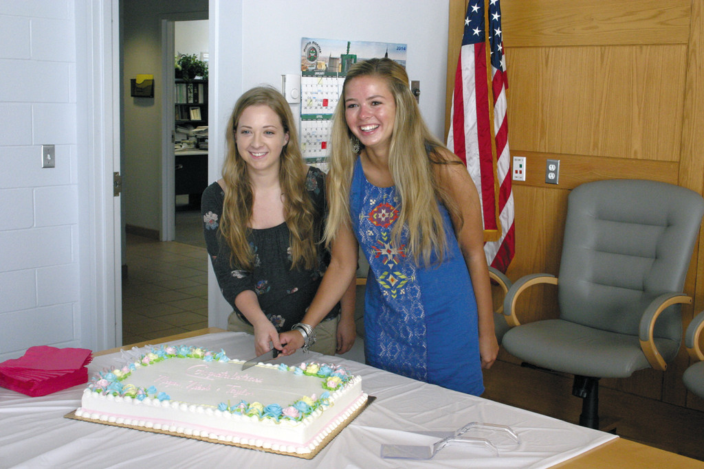 CUTTING THE CAKE: John A. Caruso Scholarship Award recipients Nicole Luiz (left) and Megan Wilks cut the cake after the ceremony.