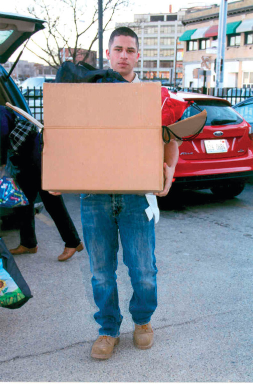 DELIVERING THE GOODS: Cameron Conroy carries a box of items he collected and delivered to DCYF children in Providence as part of his Eagle project. Items included clothing and bathroom products, such as toothpaste.