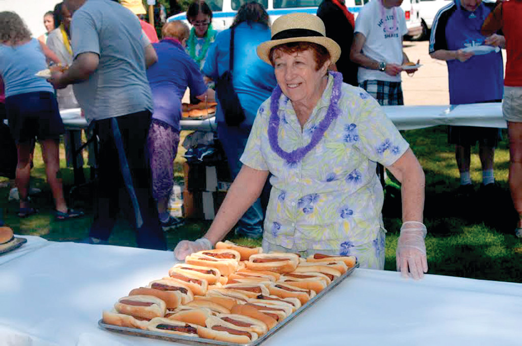 SPECIAL SERVINGS: The Rhode Island State Elks Association served plenty of food during last Thursday's Special Needs Outing in Buttonwoods. Above, Diane Carley of Tri-City Lodge No. 14 prepares a huge tray of hot dogs.