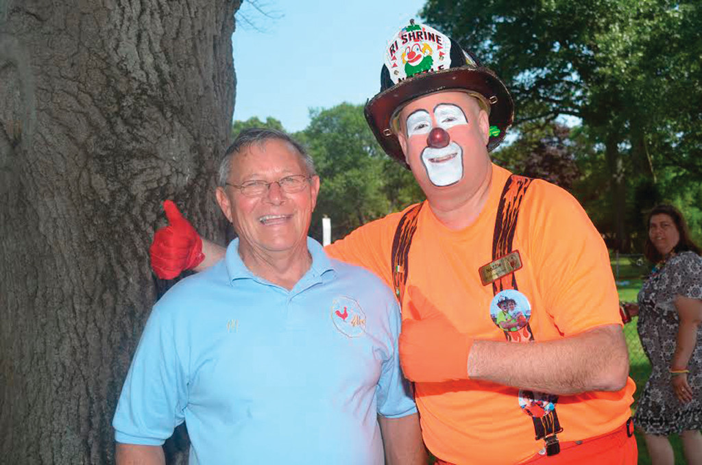"COOKIE AND MR. FIREMAN: Albert ""Cookie"" Delory, left, of Tri-City Elks Lodge No. 14 enjoys a lighter moment with ""Mr. Fireman,"" one of the fun-loving Rhode Island Shriners Clowns."