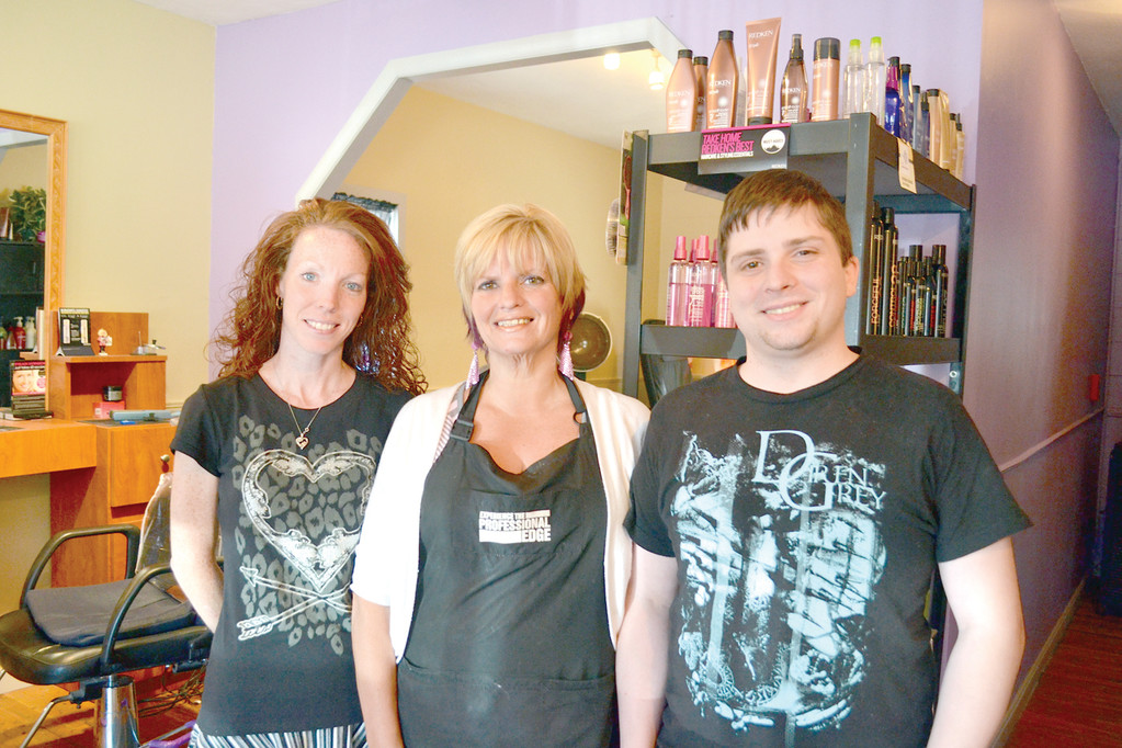 READY FOR AUG. 24 EVENT: Stylist Amanda Cramer-Destefano, salon owner and stylist Sue Mello and salon manager Cliff Choiniere IV will all be at the block party helping. Not pictured are stylist Pat Hansen and assistant Danielle Colantonio who will also be cutting hair that day.