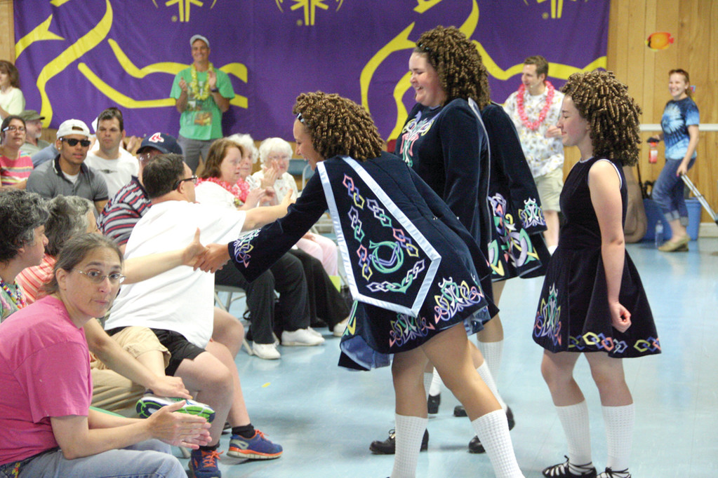 CURTSEY TO THE CROWD: Dancers from the Damhsa Irish Dance Studio greet the audience following their performance.
