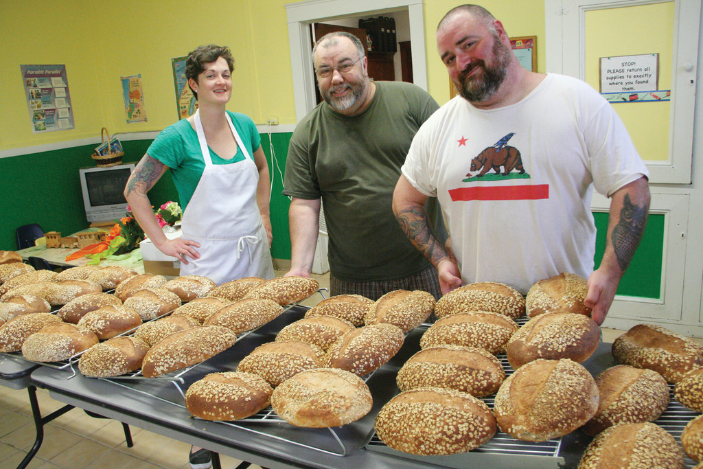 TRIO IN THE KITCHEN: Jess Jones, Phil Perry and David D'Amato with the results of their labor that starts Saturday morning and doesn't end until their bread is delivered.