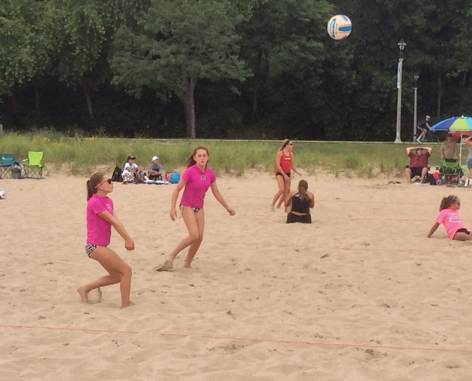 BUMP: Harrington and Sawyer compete on the sand.