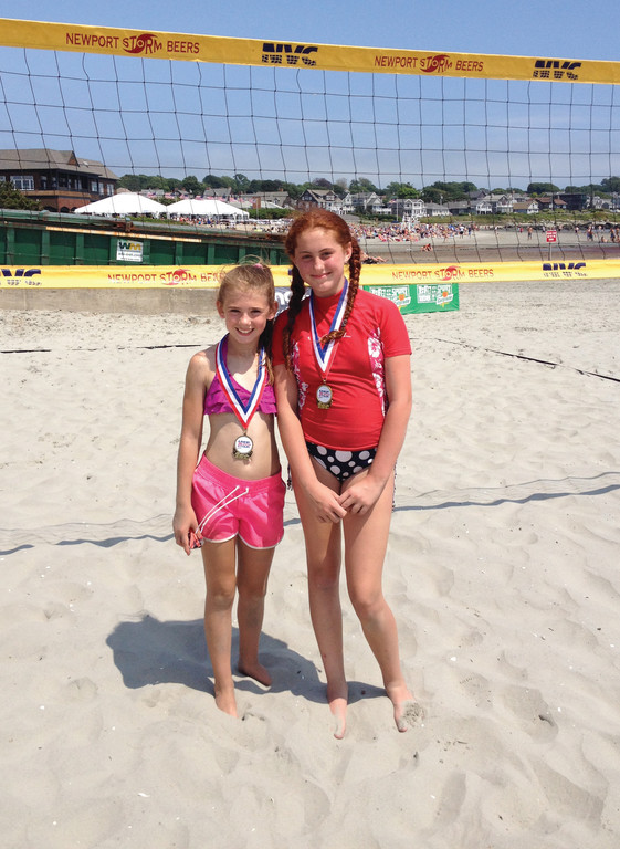 WINNERS: Jaime Harrington, left, and Haley Sawyer wear their medals after winning the New England beach volleyball title in July.
