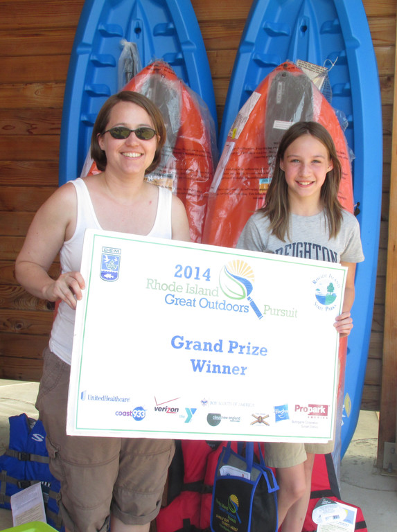 Grand prize winners Rebecca Falcasantos and daughter Kiara (aka Team Shatzi) of Providence shows off the family kayaking package they won at the 2014 Rhode Island Great Outdoors Pursuit.