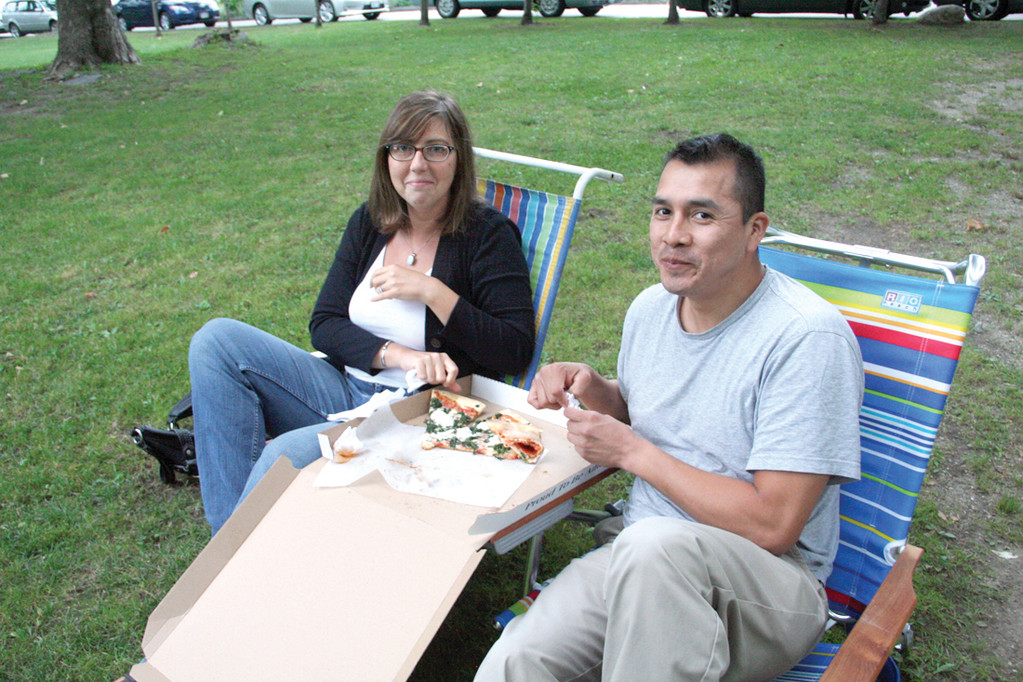 DINNER AND ENTERTAINMENT: Melissa Conroy and Juan Beteta enjoy a pizza while taking in the show.