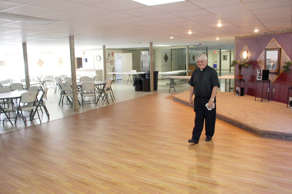 A NEW FACE: The inside of the church was redone under the guidance of Reverend Roland Simoneau. He said that his congregation has been faithful and active at the church donating their time for volunteer work.
