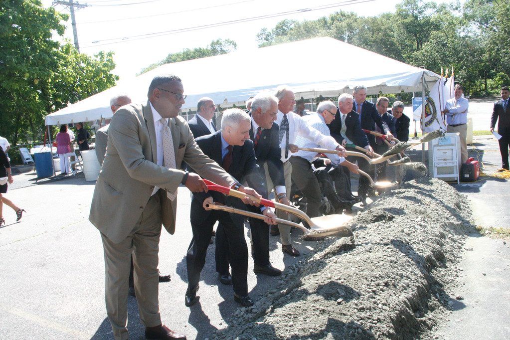 CEREMONIAL DIG: Officials join in for a symbolic groundbreaking for the $30 million Apponaug Circulator Project. Cardi Construction, which was awarded the contract, started work on the project earlier this summer.