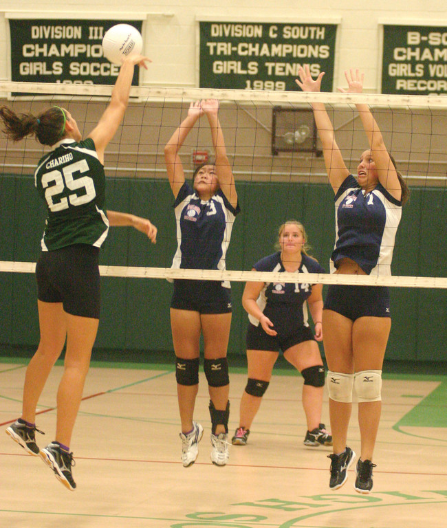 TAG TEAM: Ashley Chin (left) and Brooke Casacalenda go up for a block in a match against Chariho last year. Chin and Casacalenda are part of an experienced core leading the Titans into the Division II ranks.